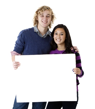 happy young couple holding a blank sign photo