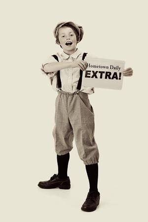 oude krant: Extra, extra vintage krantenverkoper Stockfoto