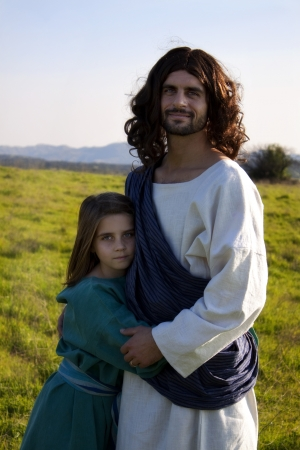 Jesus embracing a child Stock Photo