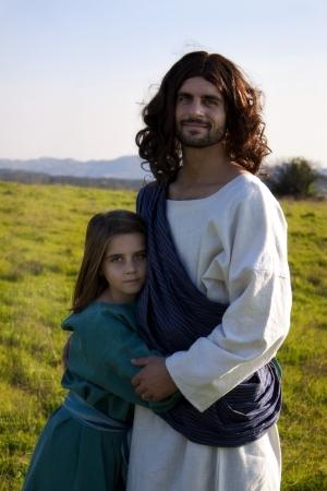 Jesus embracing a child Stock Photo