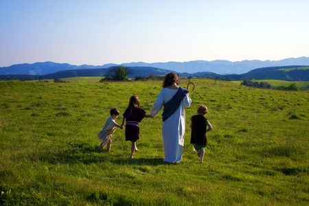 Jesus walking with children 스톡 콘텐츠