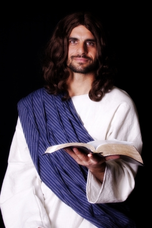 Jesus Christ holding out the Bible photo