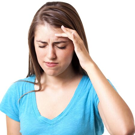young woman holding her head in pain and stress