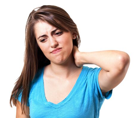 human neck: young woman holding her neck in pain