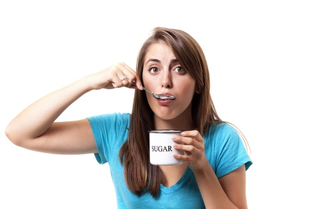 craving: young woman gives into her sugar craving
