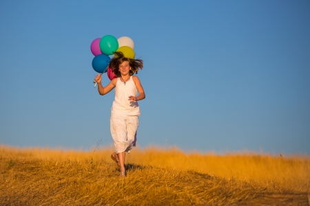 skip: young woman running with colorful balloons