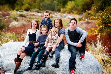 group of 6 children, toddler to teen, in Fall setting photo