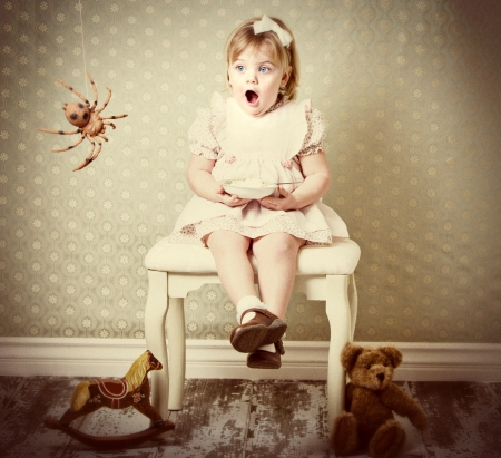 Little Miss Muffet afraid of the spider