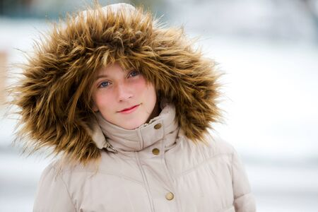 beautiful young girl bundled up for snow photo