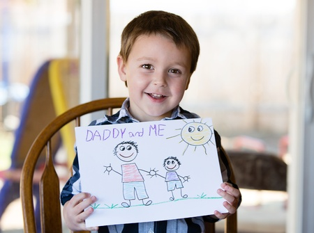 cartoon dad: Happy child holds out his art work for Daddy Stock Photo