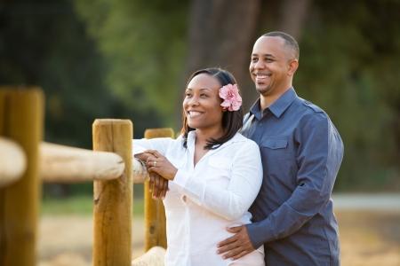 Happy couple looking forward Stock Photo