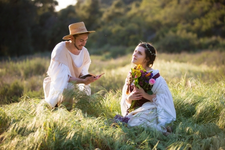 timeless: Beautiful romantic couple reading poetry in historical clothing