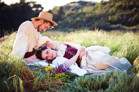 Beautiful couple in historical clothing