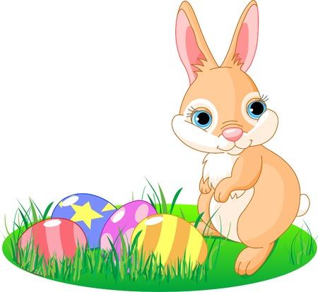 밝은 색된 계란 근처에 서있는 귀여운 부활절 토끼. 모든 개체는 별도입니다.