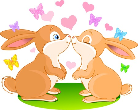 with two: Two cute rabbits in love on the spring meadow
