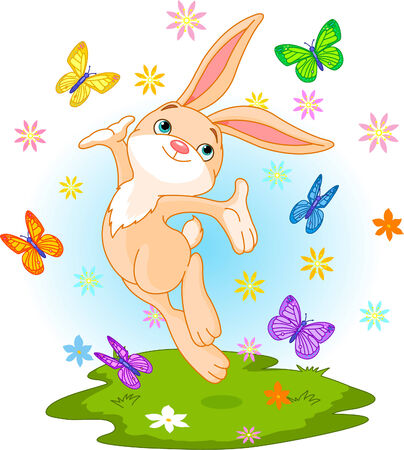 春の牧草地にジャンプかわいいウサギ