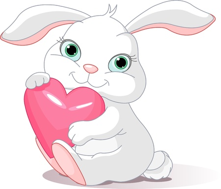 Small lovely rabbit holds love heart