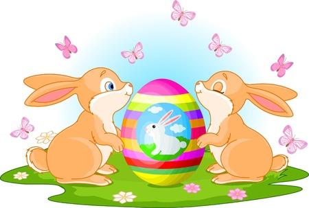 conejo caricatura: Dos conejos lindos tiene un huevo de Pascua en la pradera de primavera Vectores