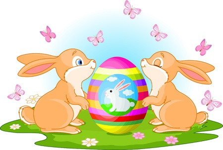 Two cute rabbits holds Easter Egg on the spring meadow Ilustracja