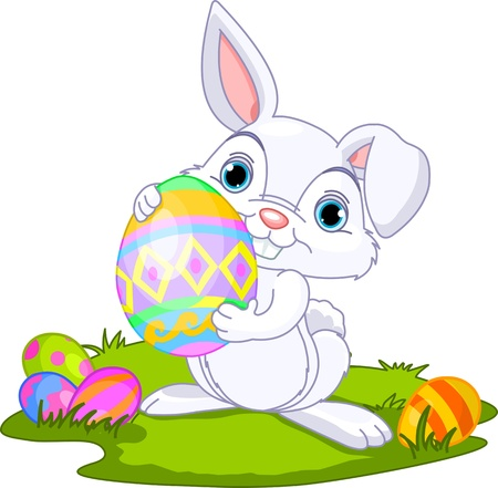 cute rabbit: Cute Easter bunny carrying egg