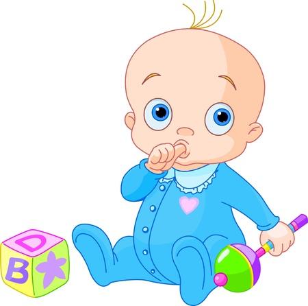 Jongen van de baby het spelen met rammelaar