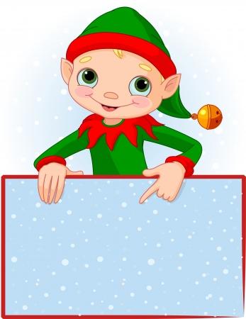 Duende de la Navidad que señala abajo a una tarjeta en blanco Place