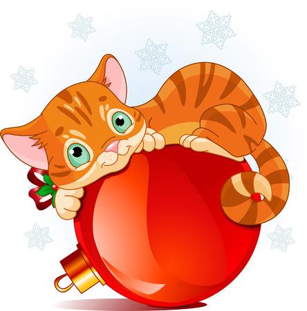 Ein niedliches Kätzchen, glücklich liegend auf einer Christbaumschmuck Kugel Standard-Bild - 23868606