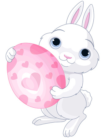 holds: A cute Easter bunny holds brightly colored egg