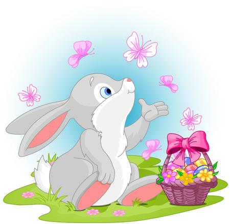 eggs basket: A cute Easter bunny sitting near Easter eggs basket.