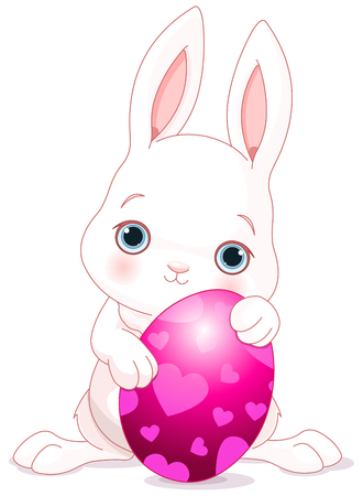 brightly: A cute Easter bunny standing near brightly colored egg