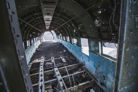 Inside of airplane wreck. In Iceland at summer Banco de Imagens