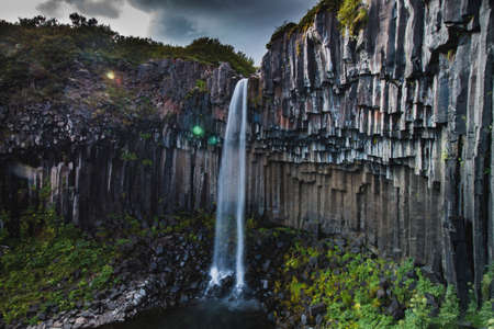 Famous Svartifoss waterfall in Iceland at summer, side view