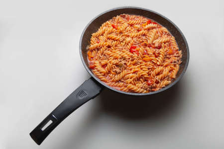 Cooked pasta in a pan white background