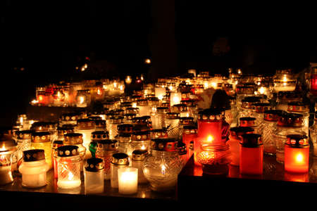 Bunch of cemetery candles in a dark
