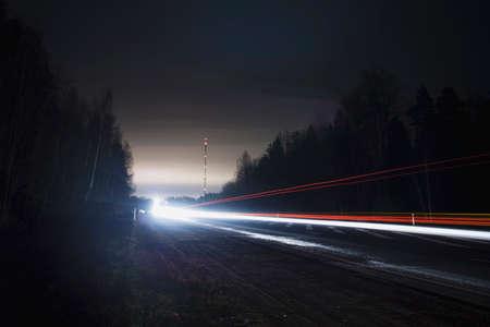 Car trail lights at night on the road Reklamní fotografie - 122352156