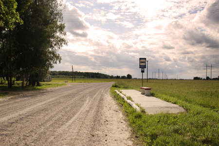 Bus stop in Lithuania village gravel road
