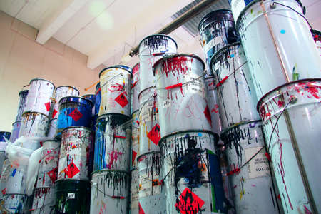 A collection of paint cans, glue buckets, mastic and toxic and hazardous material stacked Reklamní fotografie - 122352307