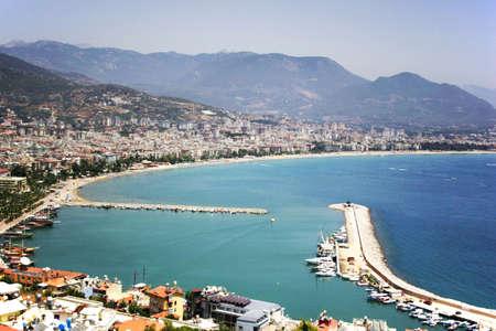 Alanya port, Famous tourist destination with high mountains. Part of ancient old Castle Reklamní fotografie