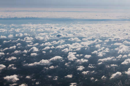 Mid-level clouds include altocumulus and altostratus during the flight