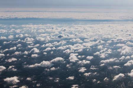 Mid-level clouds include altocumulus and altostratus during the flight Reklamní fotografie - 122352366