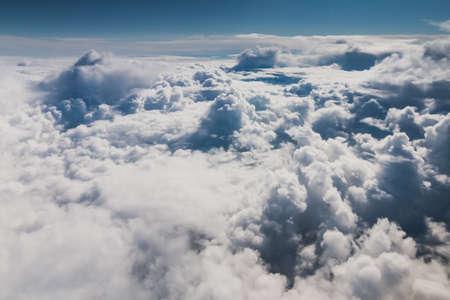 Mid-level clouds include altocumulus and altostratus during the flight Reklamní fotografie - 122352376