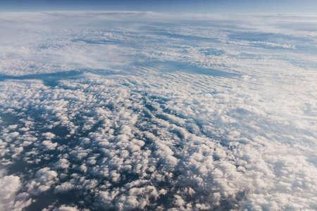 Mid-level clouds include altocumulus and altostratus during the flight Reklamní fotografie - 122352377