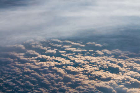 The lowest clouds in the atmosphere are stratus, cumulus, and stratocumulus during the flight Reklamní fotografie - 122352379
