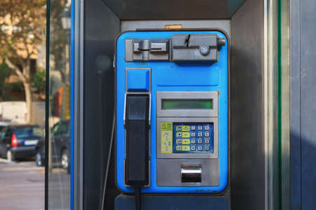 Public phone booth in Spain city Malaga blue, horizontal, Reklamní fotografie - 122352436