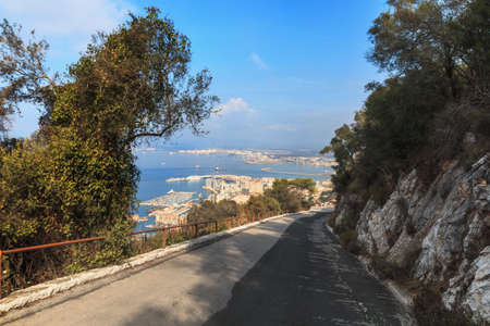 Road downhill on the edge of The Rock cliff, Gibraltar summer season day time Reklamní fotografie