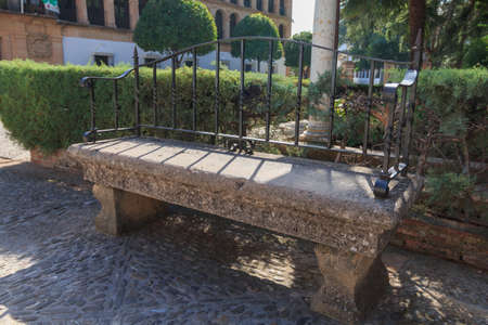 Stone bench in park Ronda, Andalusia, Spain summer season, day time,