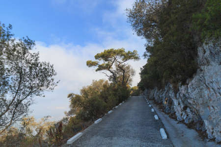 Road on the edge of cliff drive to The Rock Gibraltar summer season Reklamní fotografie