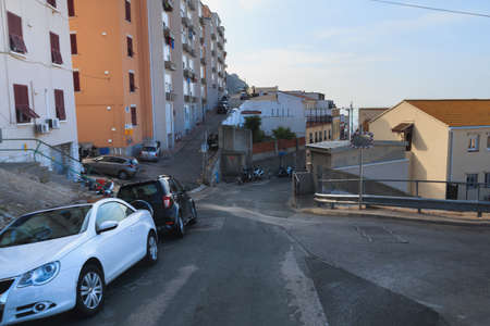 Street in city of Gibraltar parked cars on the sides summer season