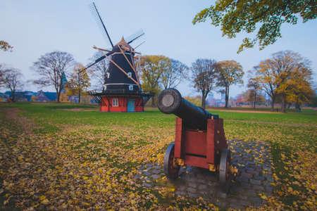 Old historic cannon near old historic windmill, Copenhagen, Denmark, Scandinavia