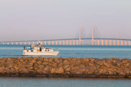 Oresund bridge and boat passing by at summer